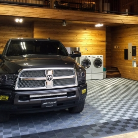 Dodge Ram 3500 in a garage with Free-Flow tile flooring