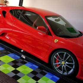 Ferrari on a lift in a garage with Free-Flow® and RaceDeck® Diamond flooring