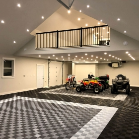 Free-Flow garage in black, graphite, and alloy design, with ATVs and off-road bike