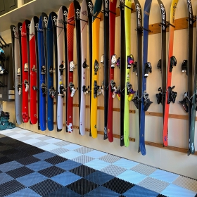 Free-Flow garage with a wall of skis