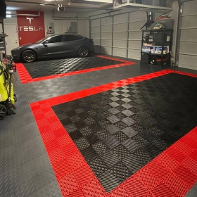 Free-Flow XLC red and black with Diamond Graphite in a multi-car garage with Tesla