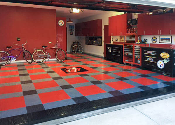 A nice garage with some beach crusiers and RaceDeck garage tiles