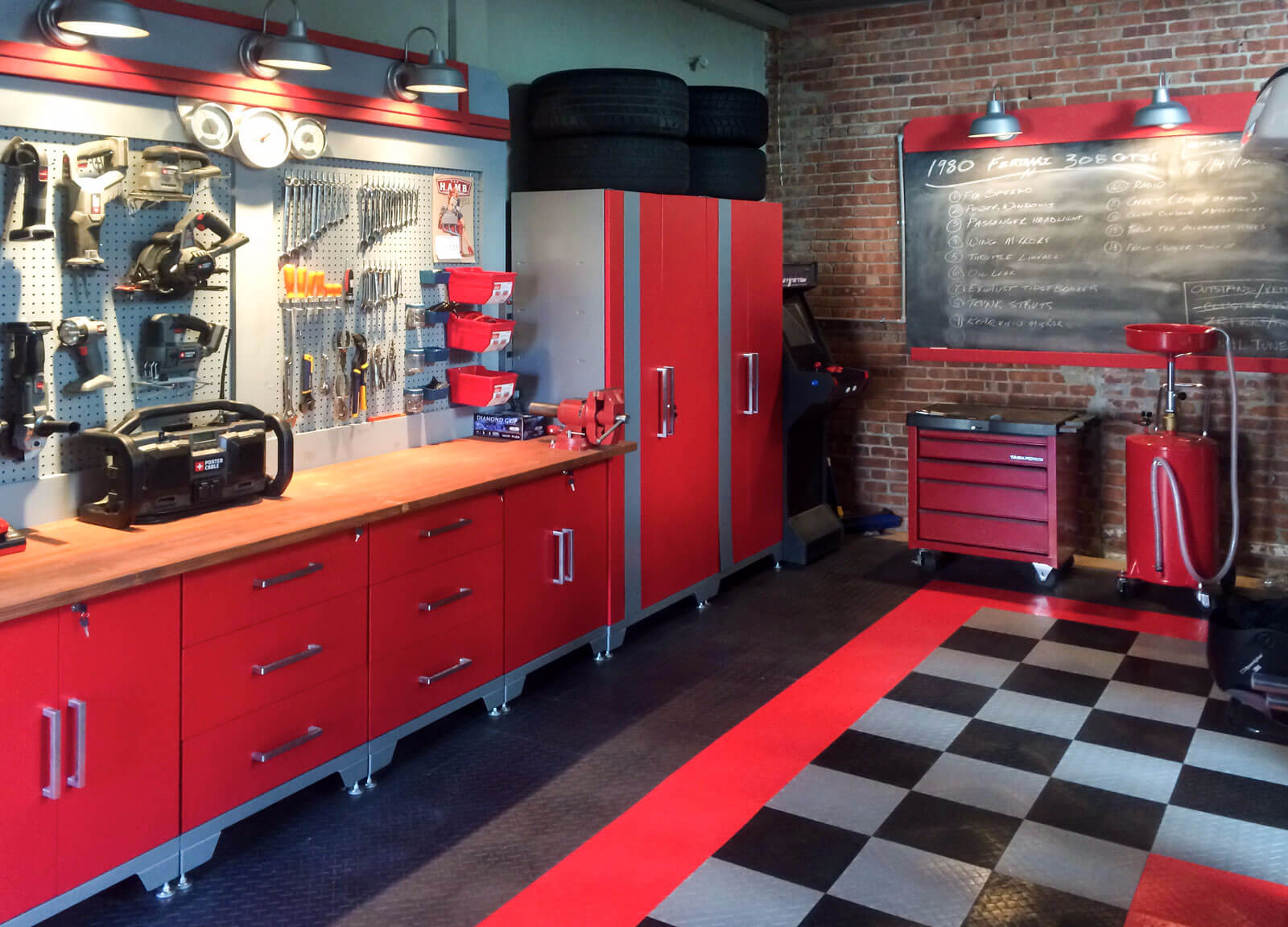 Red, black and gray home shop with matching RaceDeck Diamond flooring