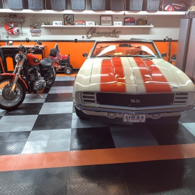 Camaro and Harley in matching themed garage with RaceDeck Diamond flooring