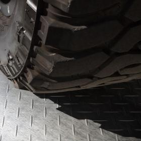 Off-road wheel on RaceDeck tile floor