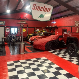 Petroliana garage with RaceDeck Diamond flooring and car collection