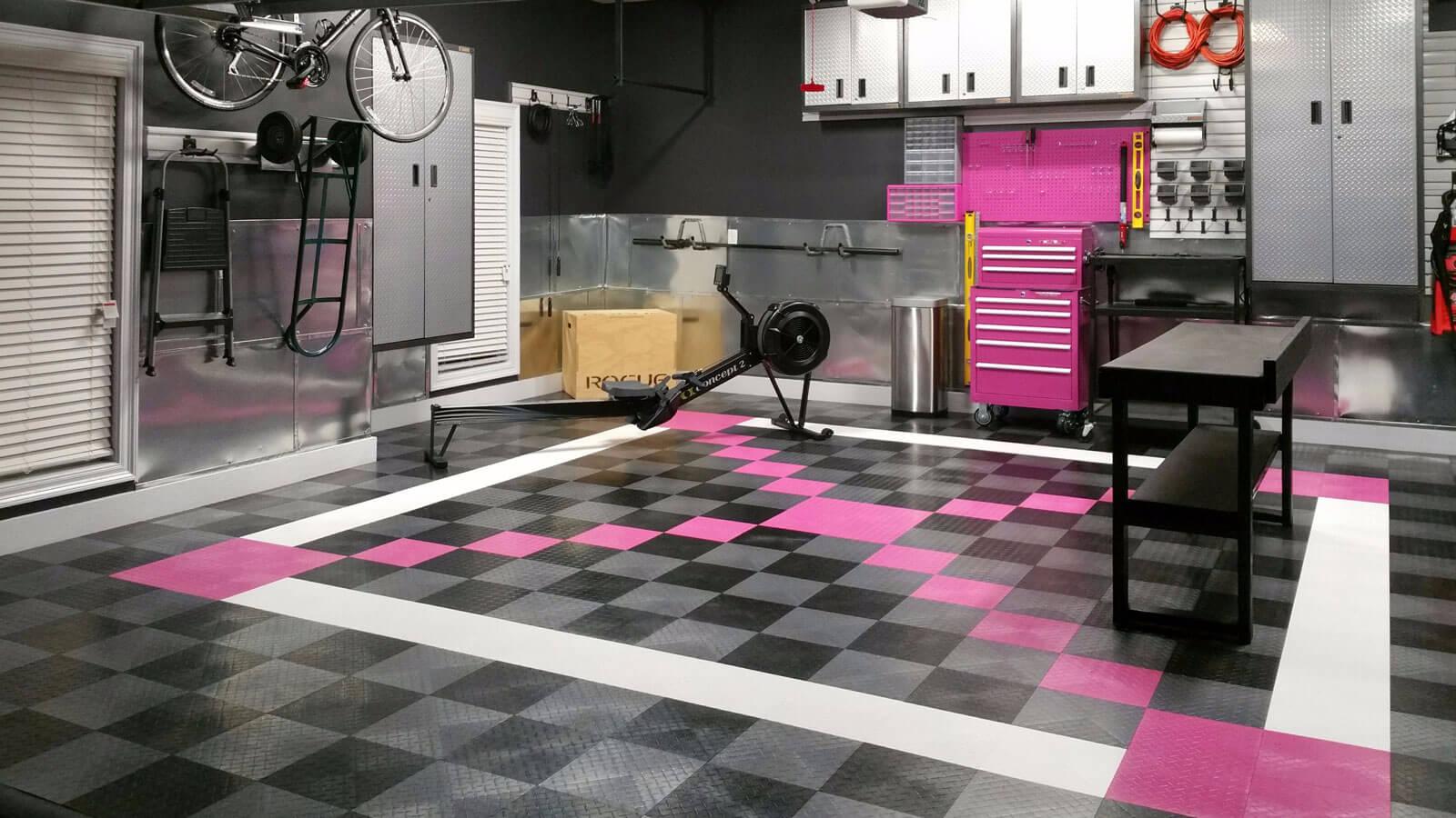 Garage floor with a pink x.
