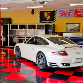 Porsche home shop with RaceDeck Tuffshield high-gloss flooring.