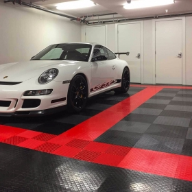Porsche GT3 RS in a garage with RaceDeck Diamond and Free-Flow draining tiles.