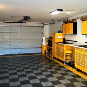 RaceDeck Diamond garage with yellow accents