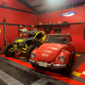 Multicolor RaceDeck Diamond garage with classic car and off-road vehicle