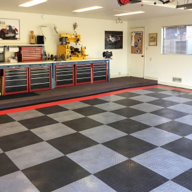 RaceDeck Diamond graphite, alloy, and red garage with workstation and cabinets