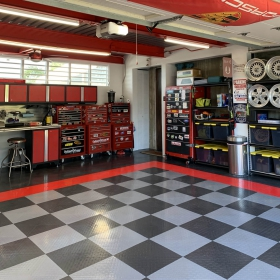 RaceDeck Diamond in graphite, alloy, and red in Porsche themed garage