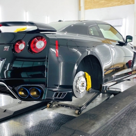 Nissan GT R in shop with RaceDeck Diamond Carbon Fiber flooring