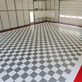 Checkerboard garage with RaceDeck diamond in white, graphite, red, black