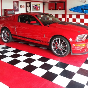 Shelby Cobra GT 500 in a matching checkered red, black and white RaceDeck Diamond garage