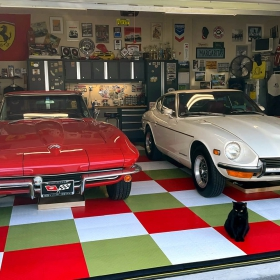 Green light, red and white RaceDeck XL garage with Corvette, Datsun, and a cool cat!