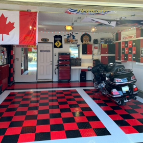 Red, black and white RaceDeck Diamond garage with motorcycle