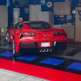 A red corvette on RaceDeck Diamond with Tuffshield.