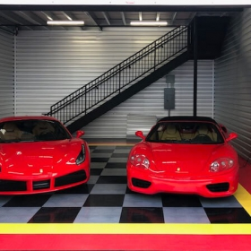 Red Ferraris in a red, yellow, alloy and black RaceDeck Diamond garage