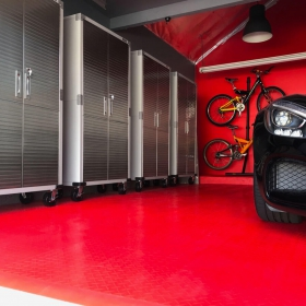 A red garage with a Mercedes
