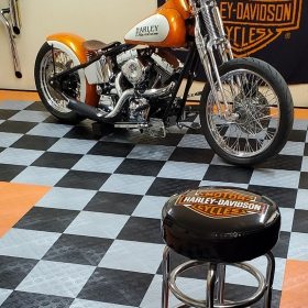 Hardtail motorcycle in Harley themed garage