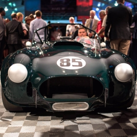 A British racing green AC Cobra on Russo and Steele Free-Flow auction floor.