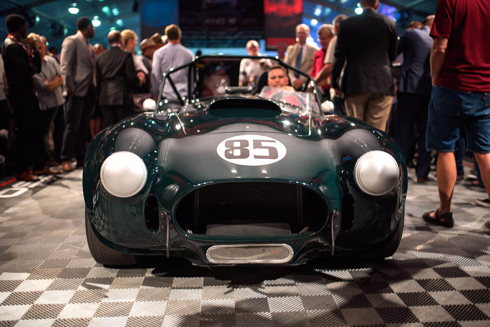 A British racing green AC Cobra on  Russo and Steele' Free-Flow auction floor.