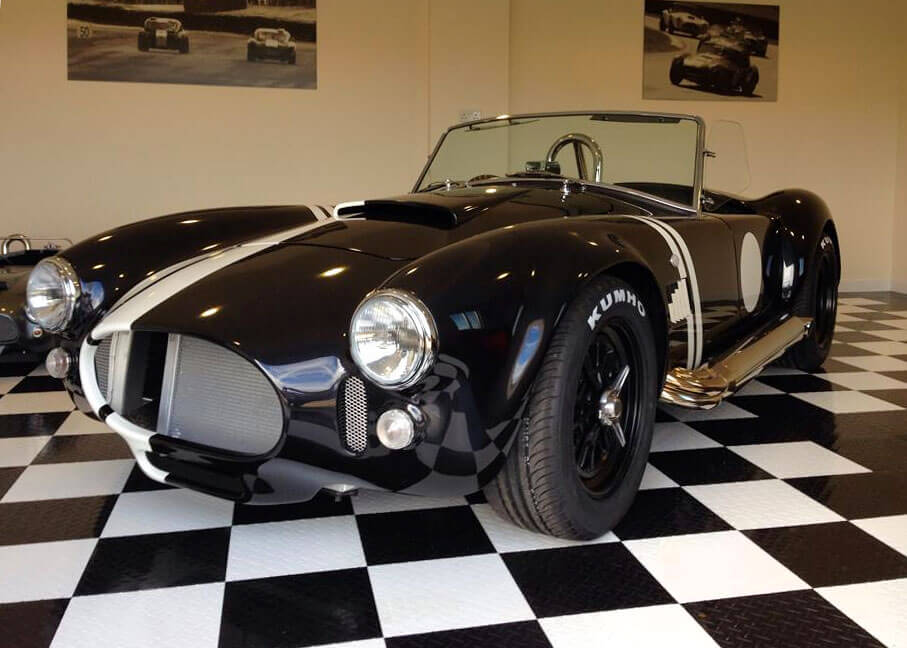 Shelby Cobra on a black and white checkerboard RaceDeck Garage Floor