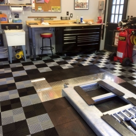A home shop floor with Free-Flow, RaceDeck Diamond, and AccuPark®