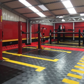 Graphite, black, yellow, red RaceDeck flooring with lifts