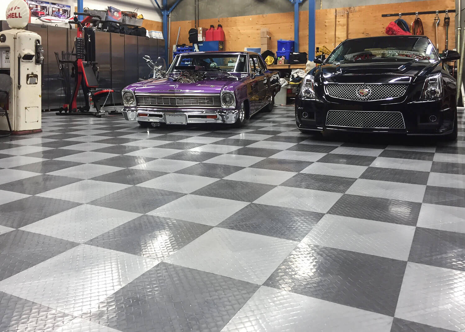 Shop floor with two cadillacs