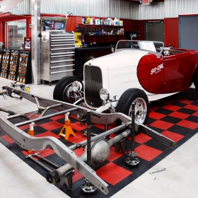 The So-cal Speed Shop Roadster on a RaceDeck shop floor parking pad