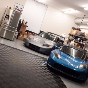 Tesla in a garage with Free-Flow and RaceDeck Diamond