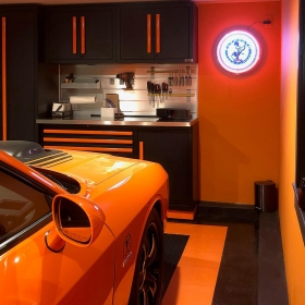 Black and orange garage with matching TuffShield Diamond floor