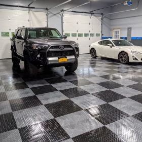 RaceDeck Tuffshield high-gloss flooring in this checkered garage