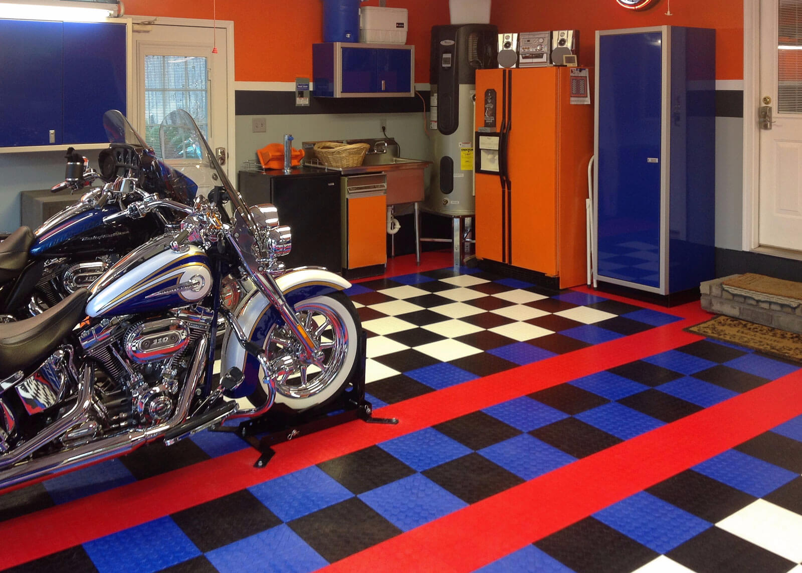 Two Harleys in a home garage with CircleTrac coin-top flooring.