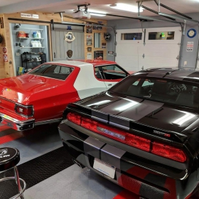 A modern and a vintage muscle car garage