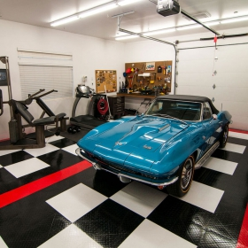 A classic Vette in a garage with exercise equipment and RaceDeck Diamond garage flooring.