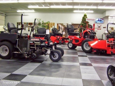 Display with riding lawn mowers