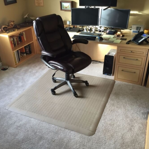 Beige CircleTrac and edging being used as an office chair mat.