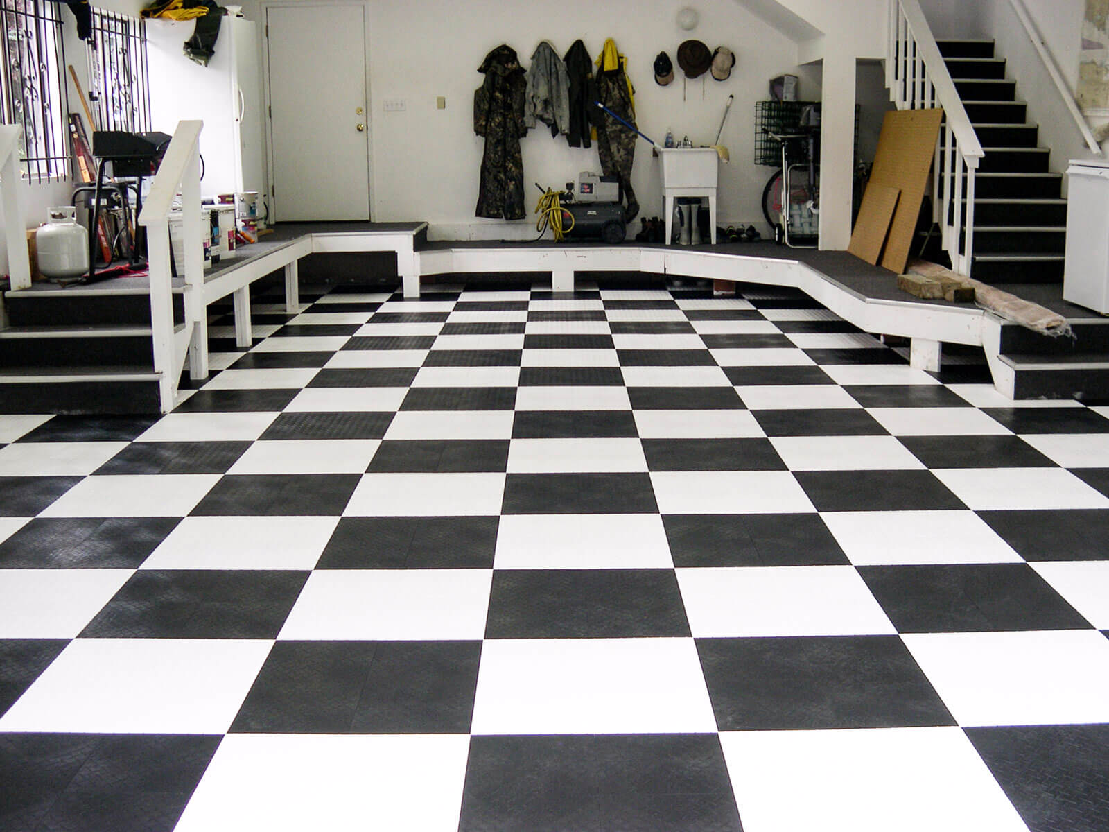 Basement area with checkered RaceDeck XL floor.