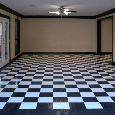 Checkered black and white RaceDeck Diamond flooring interior