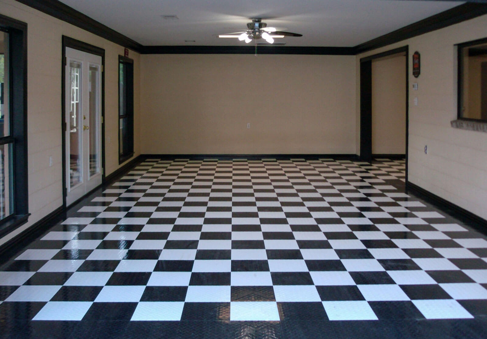 Checkered black and white RaceDeck Diamond flooring interior