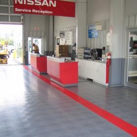 Nissan commercial garage with RaceDeck Diamond flooring