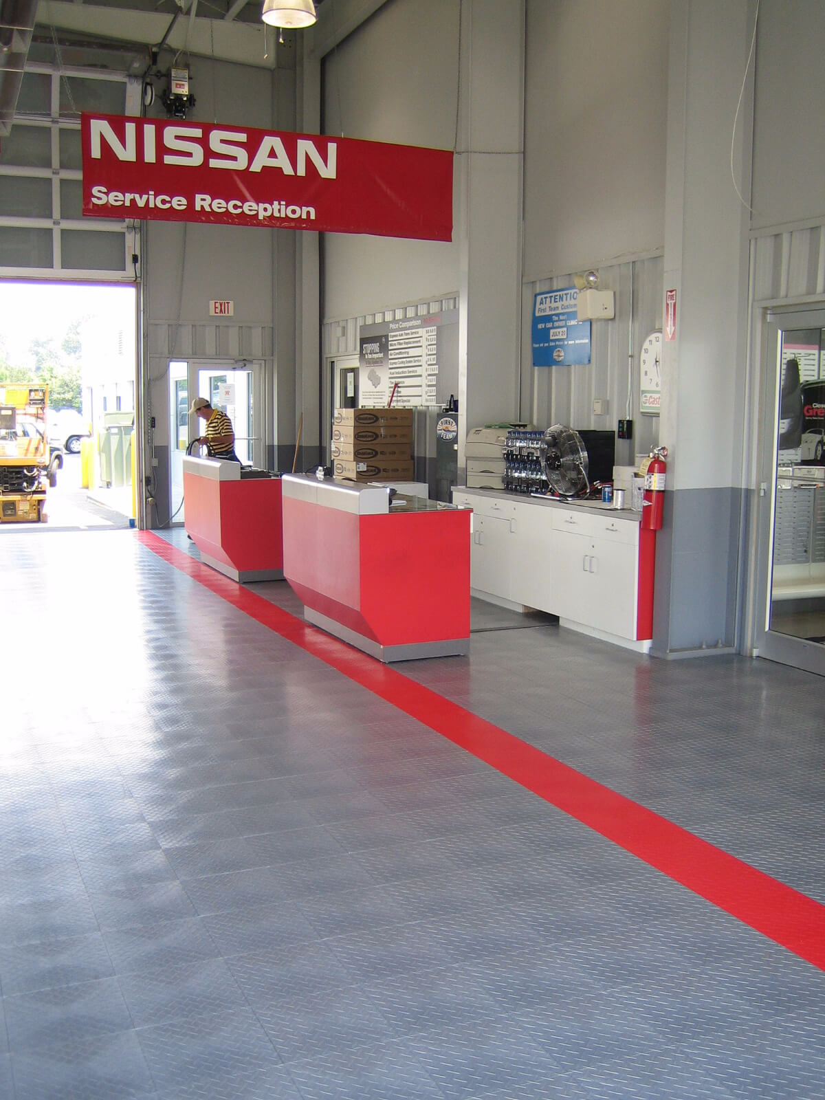 Nissan commercial garage with RaceDeck Diamond flooring