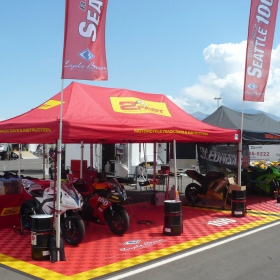 Motorcycle racing display with Free-Flow flooring