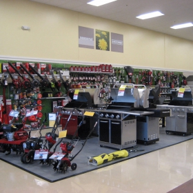 Outdoor products display at Sears, with RaceDeck Diamond flooring in alloy.