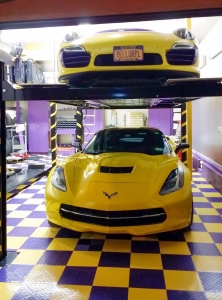 Cars in a yellow and purple RaceDeck garage