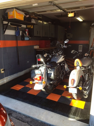 Two motorcycles on RaceDeck Diamond orange, alloy, and black